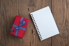 Notebook with gift Royalty Free Stock Photo