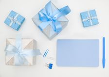 Notebook and gift box on white background royalty free stock image