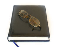 Notebook and glass Stock Photography