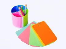 Notebook and glass of crayons. Royalty Free Stock Images