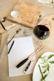 Notebook and glass of wine Stock Photos