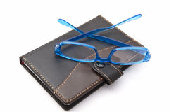 Notebook and Glasses Stock Photos