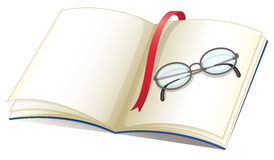 Notebook and glasses Royalty Free Stock Photos