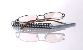 Notebook and glasses Royalty Free Stock Image