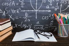 Free Notebook, Glasses And A Glass With Pencils On Chalkboard Background With Formulas. Teacher&x27;s Day Concept And Back To School Royalty Free Stock Photos - 146937028