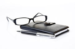 Notebook, glasses and black pen Stock Image