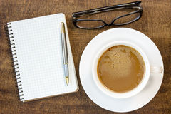 Notebook, glasses and  coffee cup Royalty Free Stock Photos