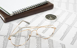 Notebook with glasses Stock Photography