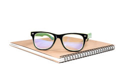 Notebook and glasses Royalty Free Stock Images
