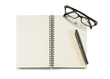 Notebook with glasses Stock Photo