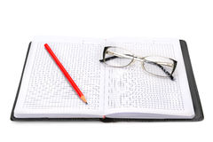 Notebook and glasses isolated on white Royalty Free Stock Images