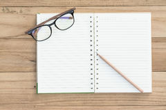 Notebook with glasses Stock Photos
