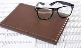 Notebook with glasses Royalty Free Stock Photos