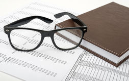 Notebook with glasses Royalty Free Stock Photography