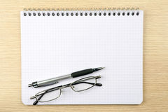 Notebook, glasses and pen Stock Image