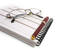 Notebook, glasses and pen Stock Photo