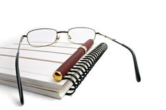 Notebook, glasses and pen Royalty Free Stock Image