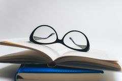 Notebook with glasses and pen, Book with glasses, Blue notebook royalty free stock photo