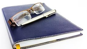 Notebook glasses and pen Stock Photo