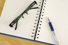 Notebook, glasses and pen. Royalty Free Stock Image