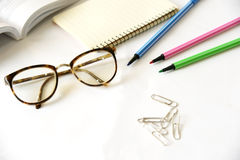 Notebook with glasses and pen on table, close up Royalty Free Stock Photos