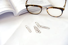 Notebook with glasses and pen on table, close up Stock Photos