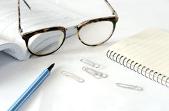 Notebook with glasses and pen on table, close up Royalty Free Stock Photography