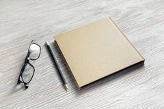 Notebook, glasses, pencil stock images