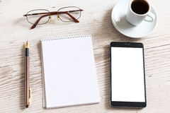 Notebook with glasses, pencil, smart phone Royalty Free Stock Photo