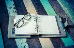 A notebook and glasses Royalty Free Stock Photography