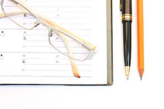 Notebook glasses and yellow pencil Stock Photo
