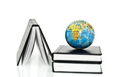 Notebook and globe Stock Image