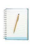 Notebook and gold pen Royalty Free Stock Photo