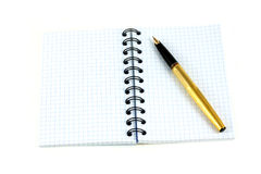 Notebook and golden fountain pen Royalty Free Stock Photography