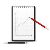 Notebook with graph. Red pencil drawing positive graph on the notebook Royalty Free Stock Photography