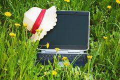 Notebook  on the Grass Royalty Free Stock Photos