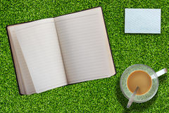 Notebook on Grass Royalty Free Stock Photo