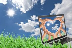 Notebook on grass with blue sky Royalty Free Stock Photo