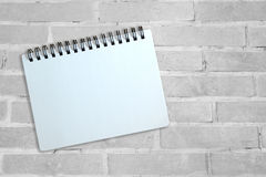 Notebook on gray brick wall Royalty Free Stock Images