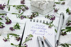 Stationery on small purple flowers and silver ribbon Royalty Free Stock Photography