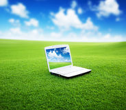 Notebook on the green field Royalty Free Stock Photography