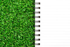 Notebook on green grass. Stock Photography