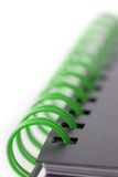 Notebook with green spiral Stock Photos