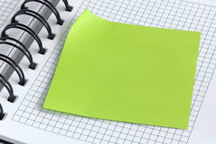 Notebook and green sticker Royalty Free Stock Photography
