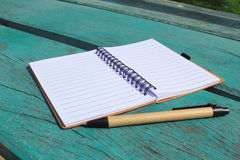 Notebook on the green table Royalty Free Stock Photos