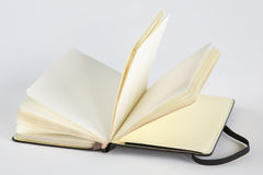 Notebook on grey Stock Photography