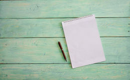 Notebook on grunge wood Royalty Free Stock Photography