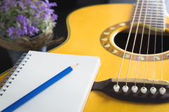 Notebook on guitar for song writer. Blank notebook on guitar for song writer Royalty Free Stock Images