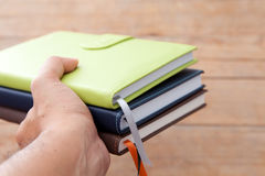 Notebook in a hand Stock Images