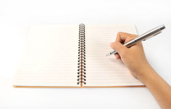 Notebook in hand. Pen in hand Stock Photography